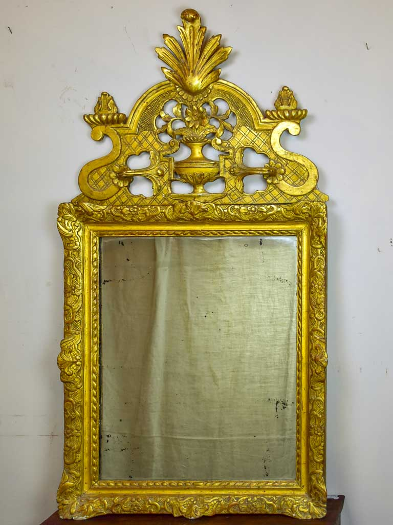 18th Century Louis XV gilded mirror with pediment