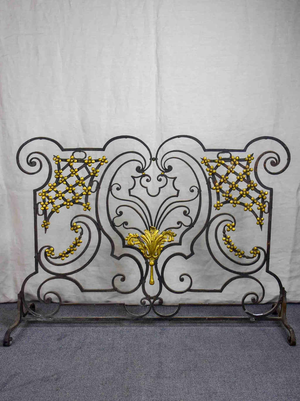 Wrought iron fire screen with flowers