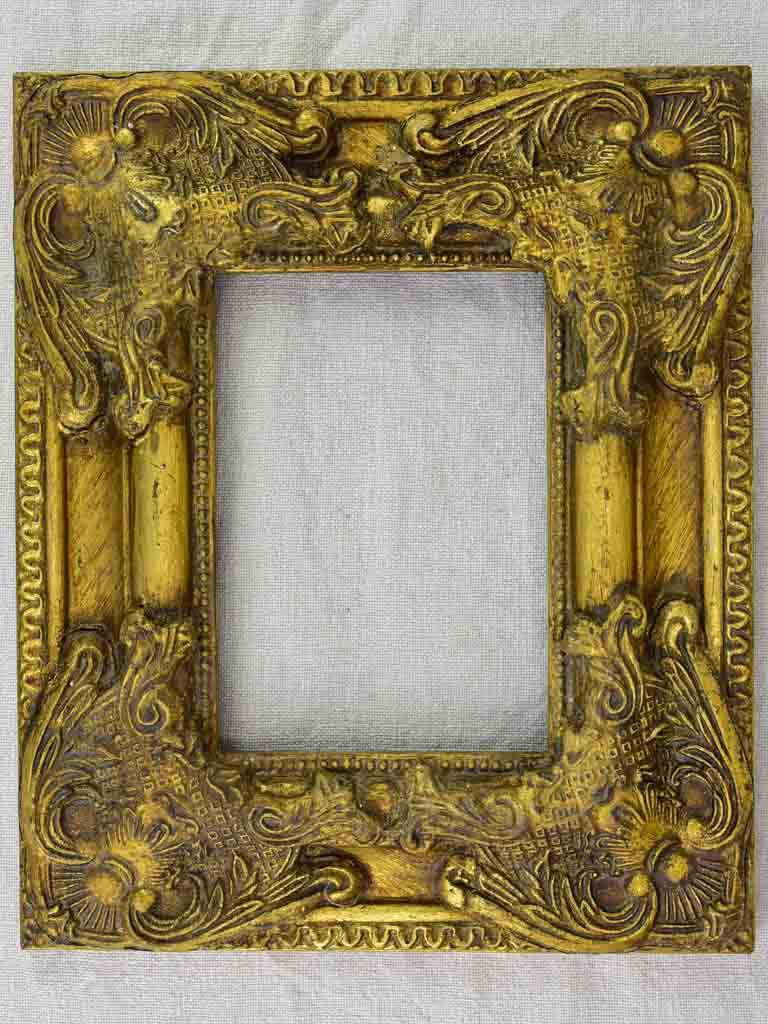 Timber and stucco frame with gold patina