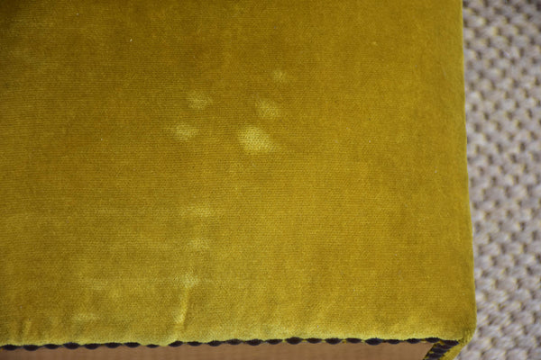 Antique footrest with mustard velvet upholstery