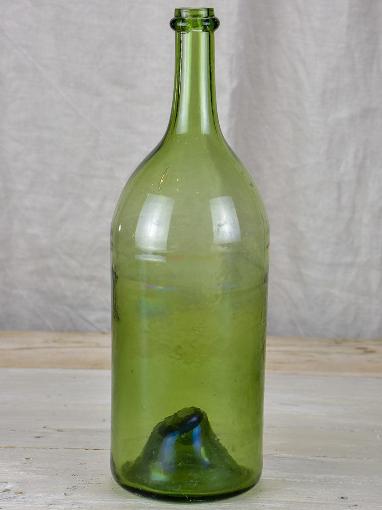 Antique French green glass bottle