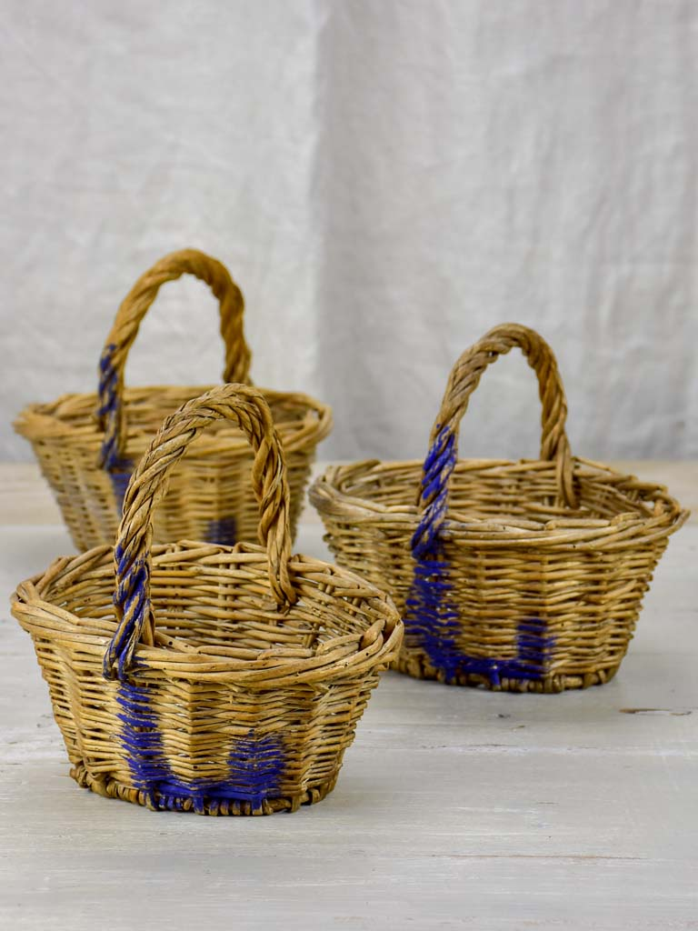 Three antique French raspberry baskets