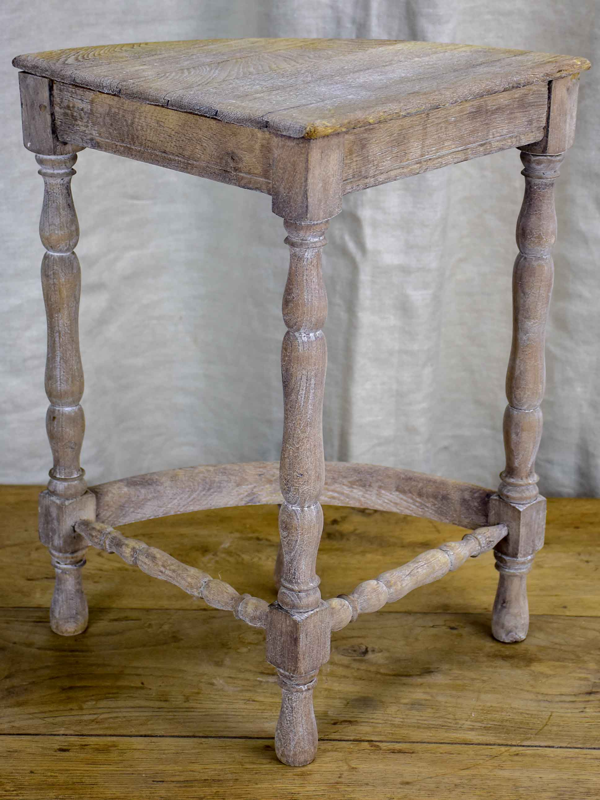 Antique French oak picnic table with four nested wedge chairs
