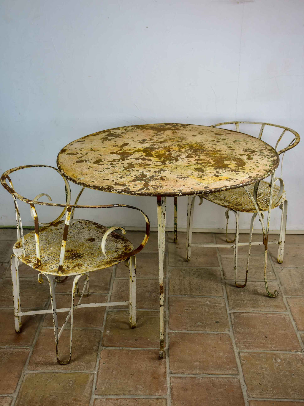 Antique French garden table with two armchairs