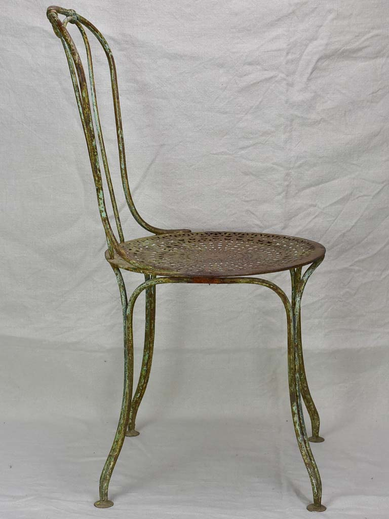RESERVED Antique French garden chair with perforated seat and timeworn patina