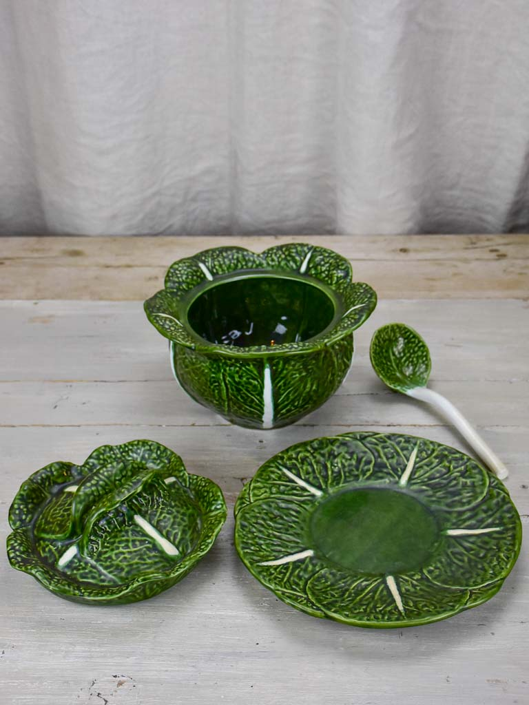 Collection of vintage cabbage leaf plates, platters and soup tureen
