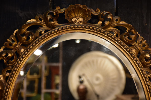 Antique French oval mirror with giltwoood frame