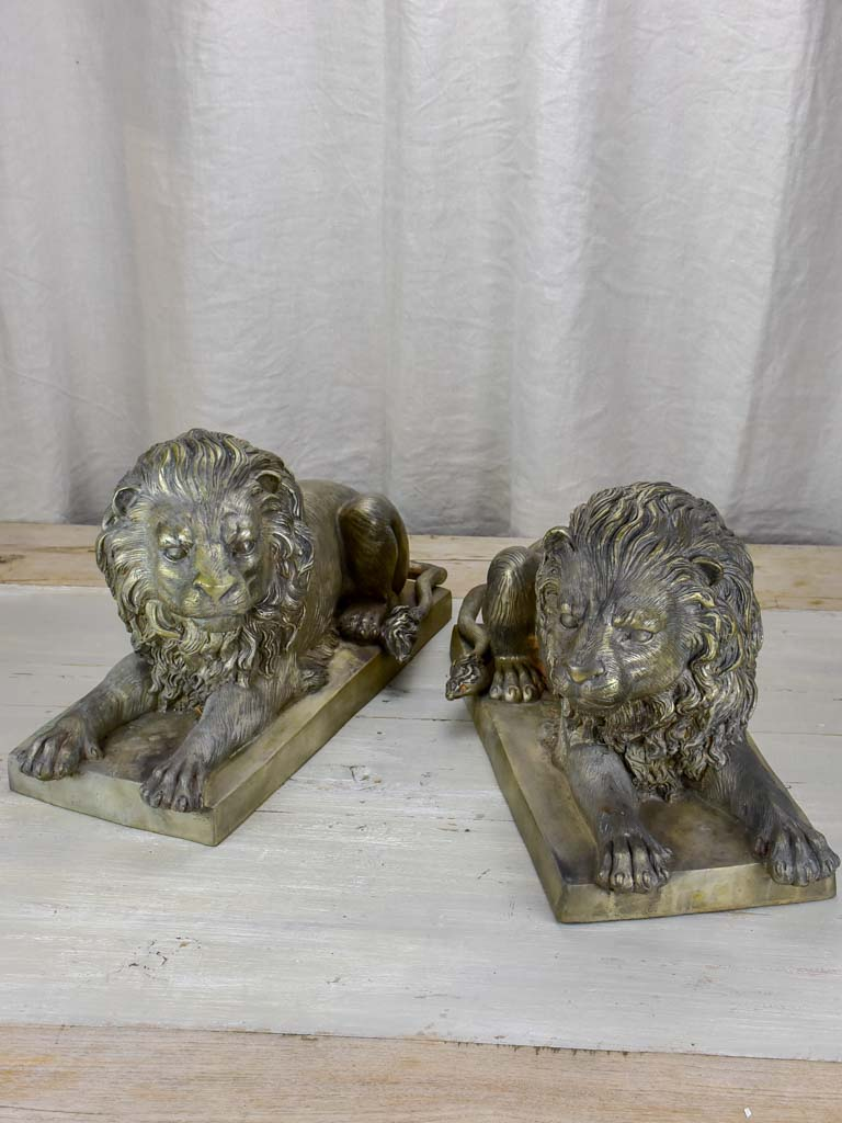Pair of antique French lion sculptures in bronze