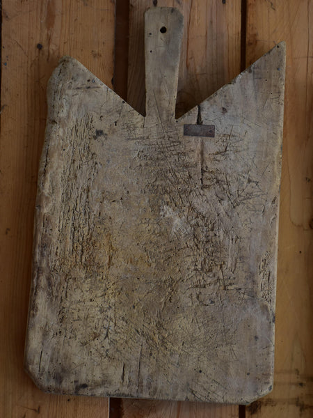 Antique French cutting board with repairs and angled corners