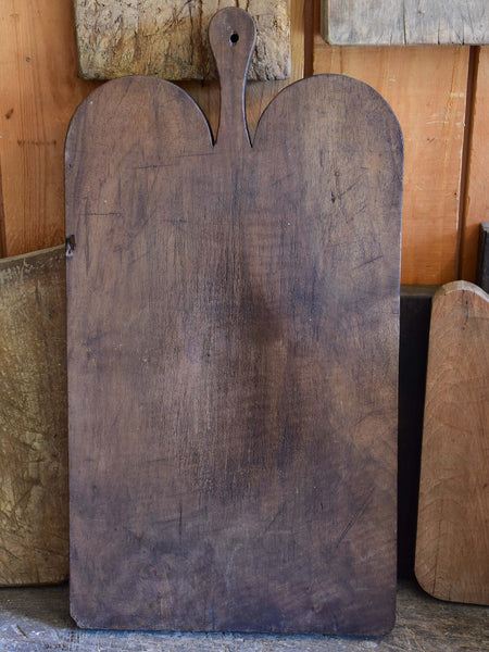 Antique French cutting board with dark timber