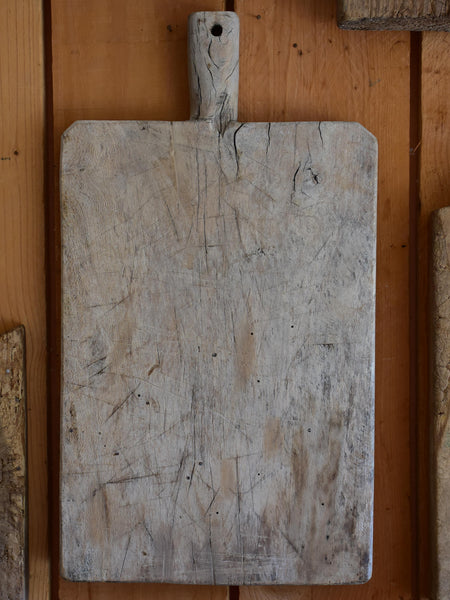 Antique French cutting board with beveled corners and grey timber