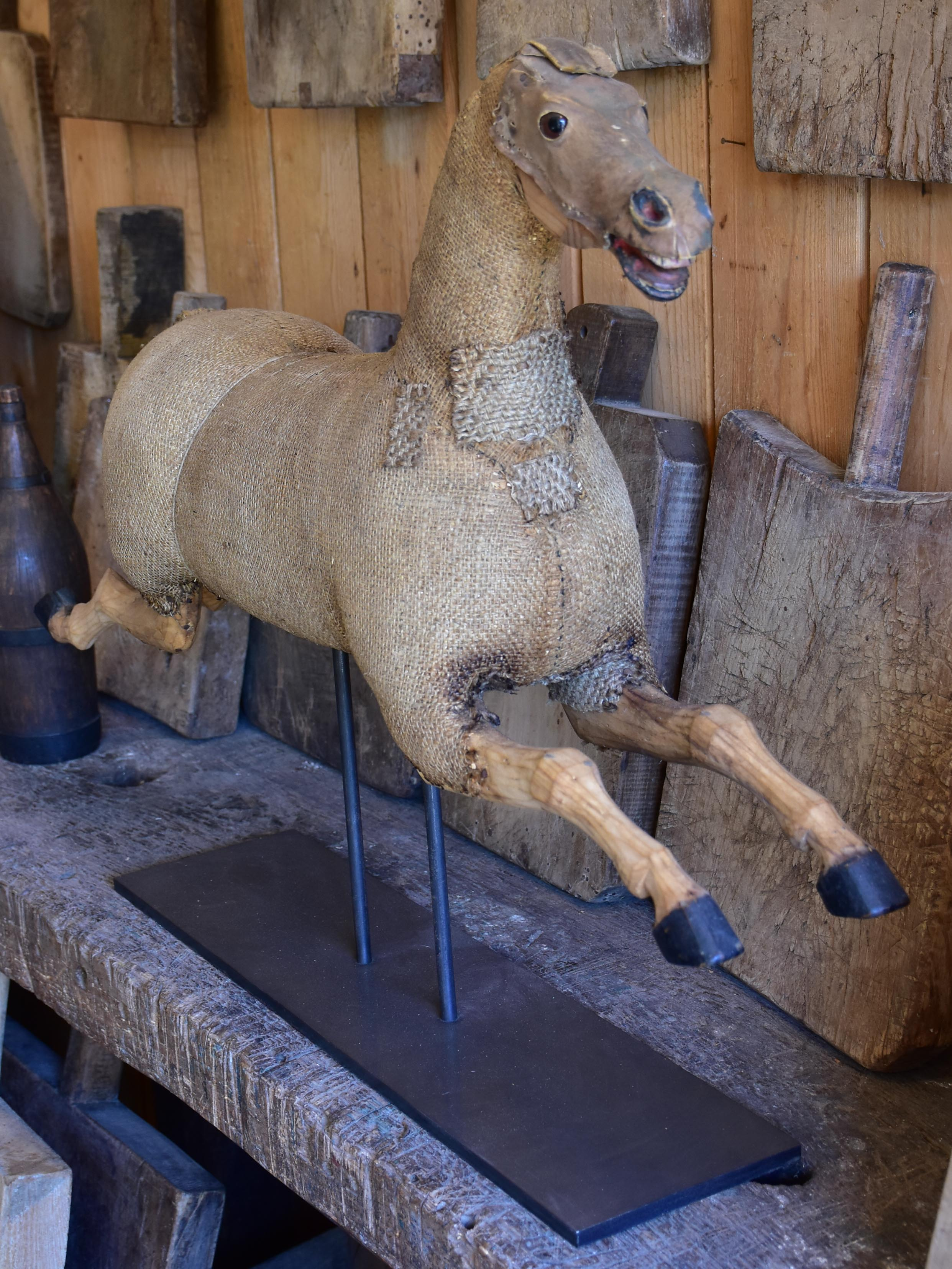 Antique French toy horse mounted on a stand