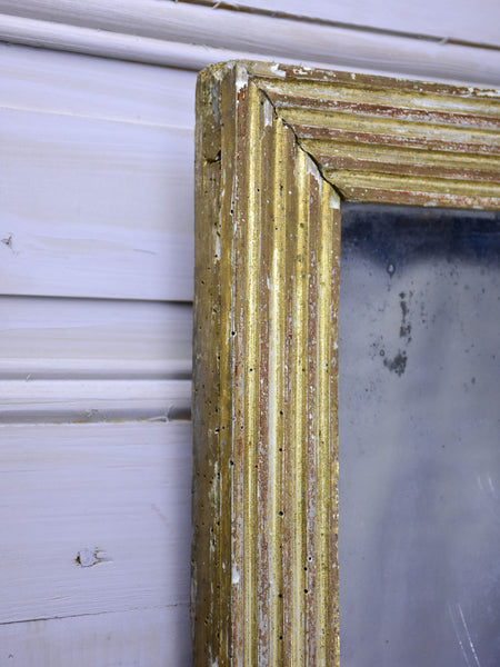 Antique Louis XVI mirror with reeded frame