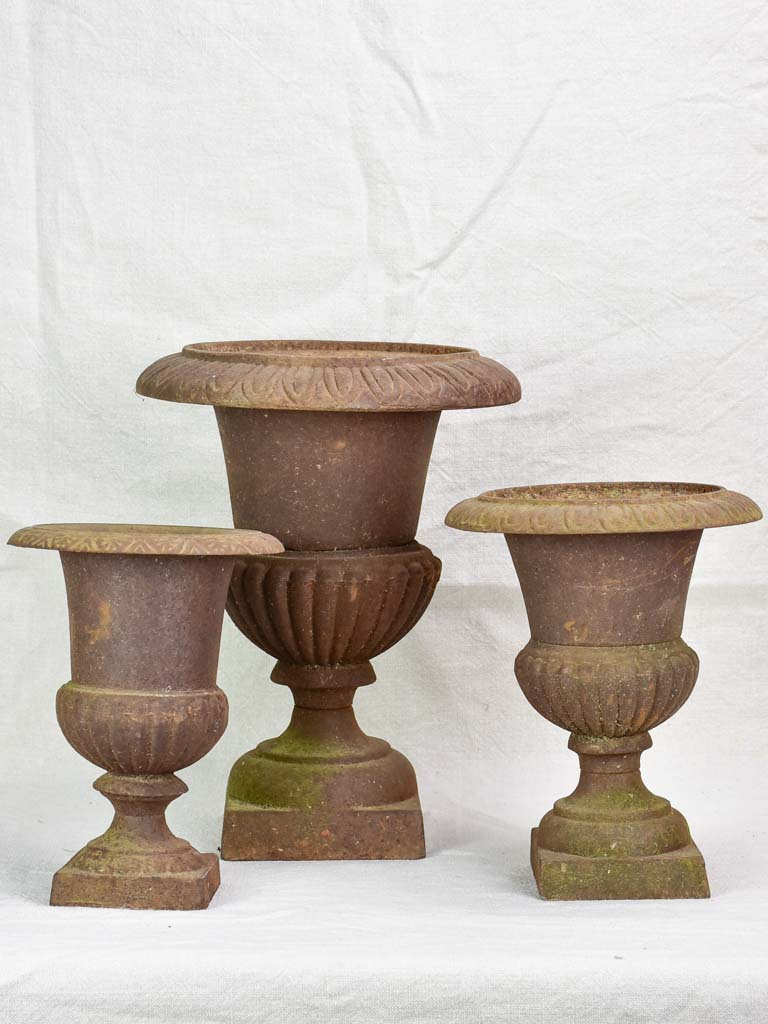 Three antique French cast iron Medici urns
