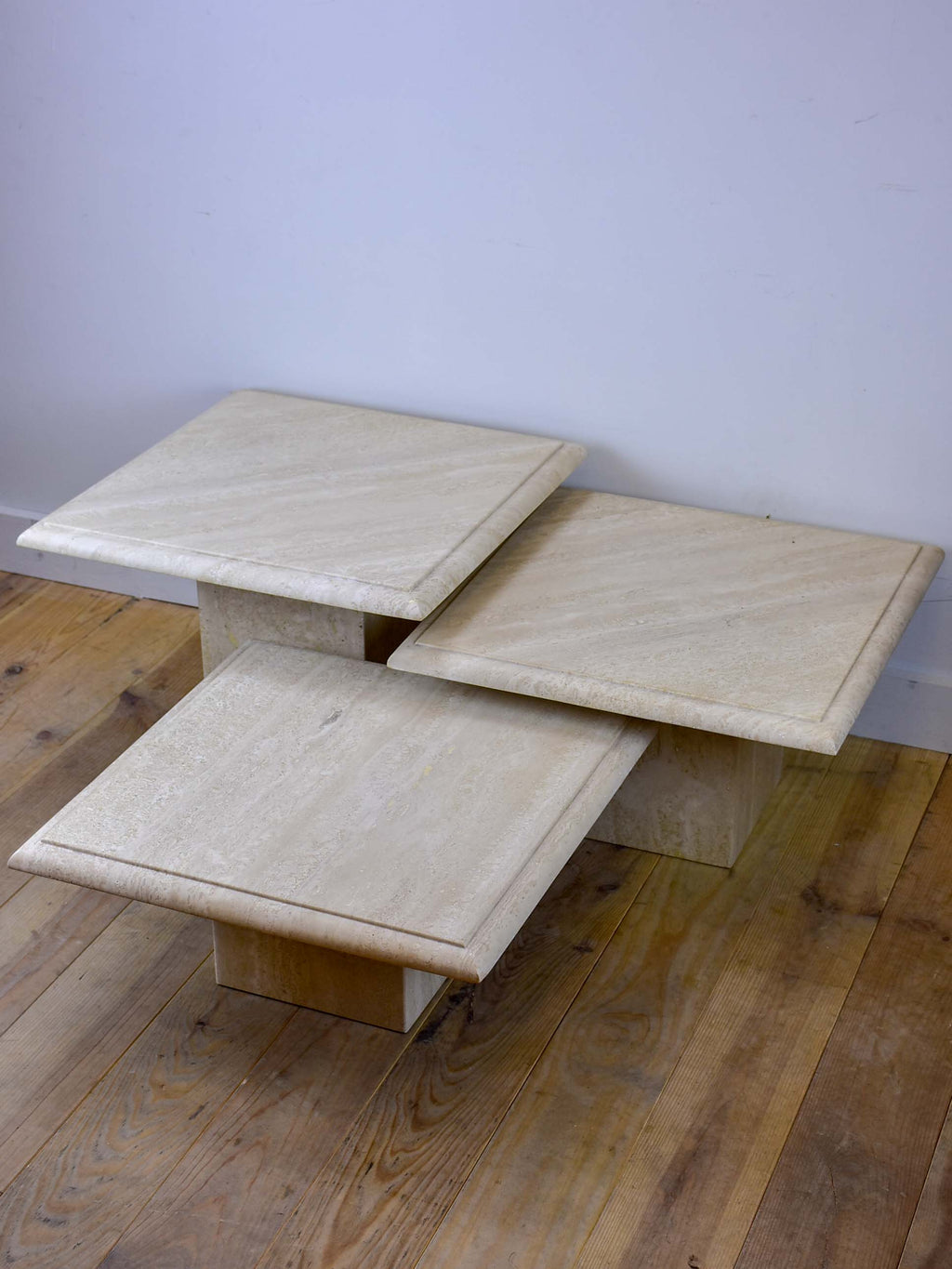 Three vintage travertine nesting side tables