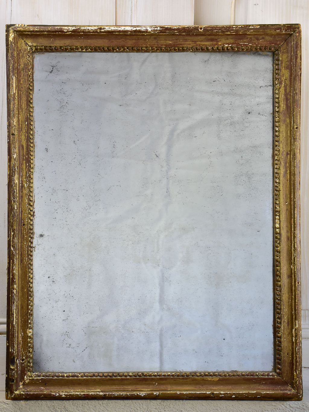 Rustic Louis XVI mirror with gilded frame