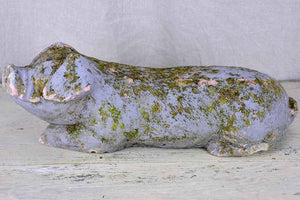 Antique French statue of a resting pig