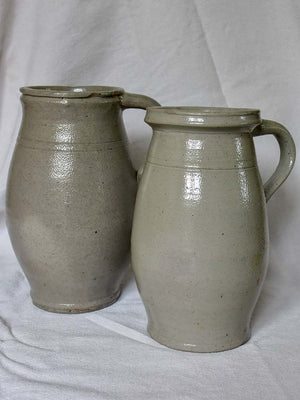 Two antique French milk pitchers - gray sandstone