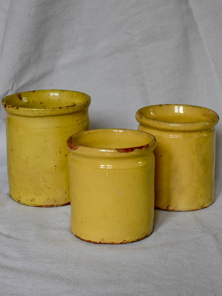 Collection of three antique French preserving pots with yellow glaze