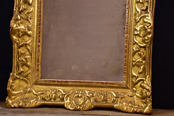 19th century Louis XV style gilded mirror with pediment