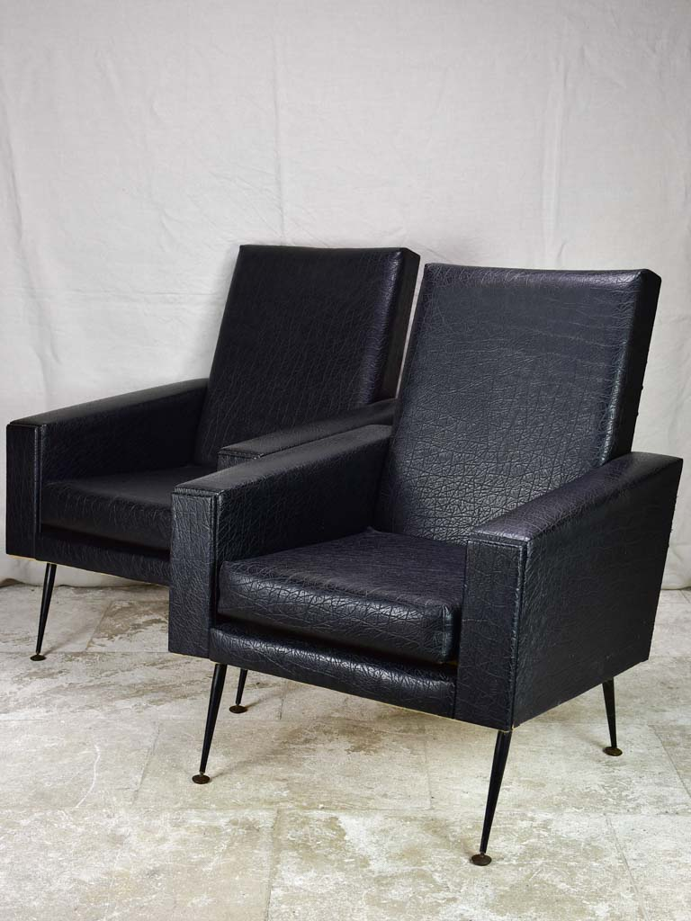 Pair of 1950's armchair faux black leather
