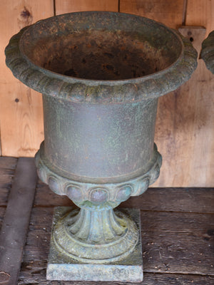 Pair of antique Medici urns with dark green patina