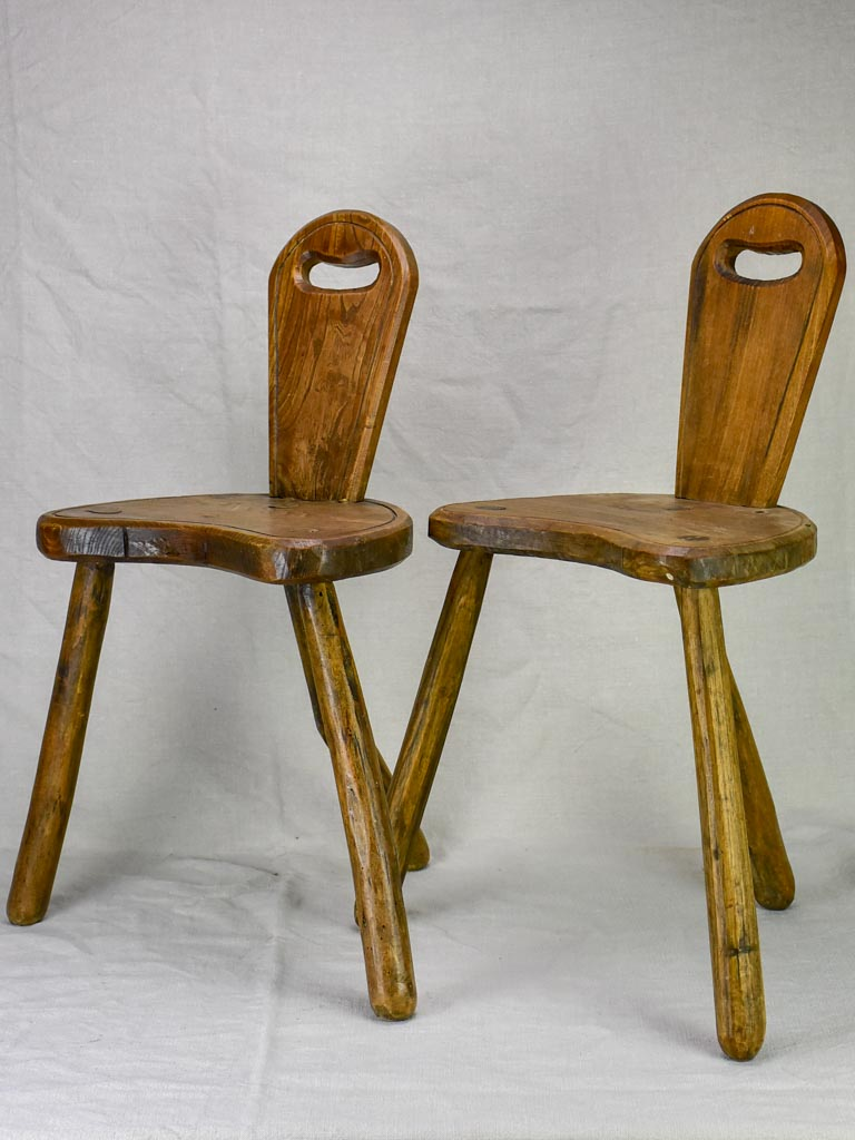 Pair of primitive milking stools with back rests