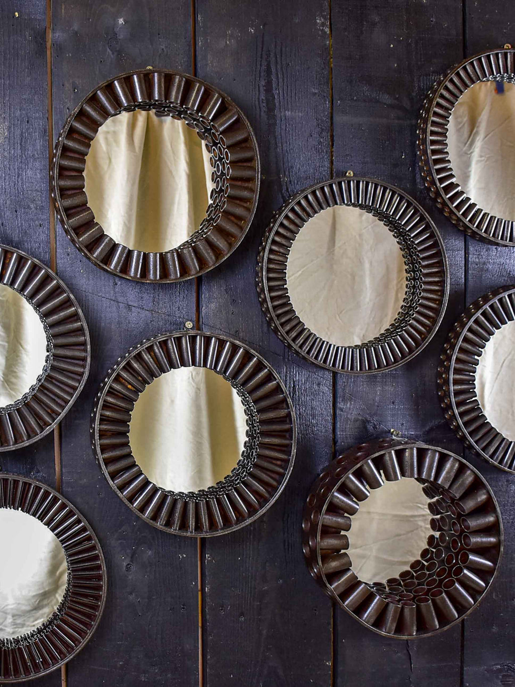 Round mirrors made from salvaged industrial materials
