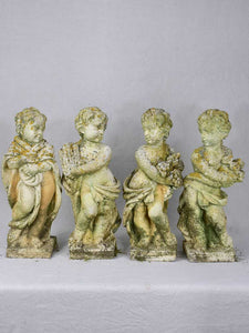 Collection of four vintage cherubs representing the four seasons - weathered patina 19¼""