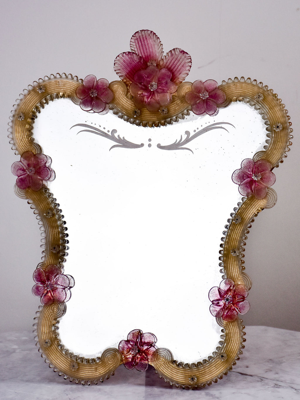 Small antique Venetian mirror with pink flowers