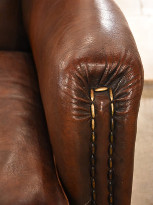 Dark French leather studded club chair - clouté