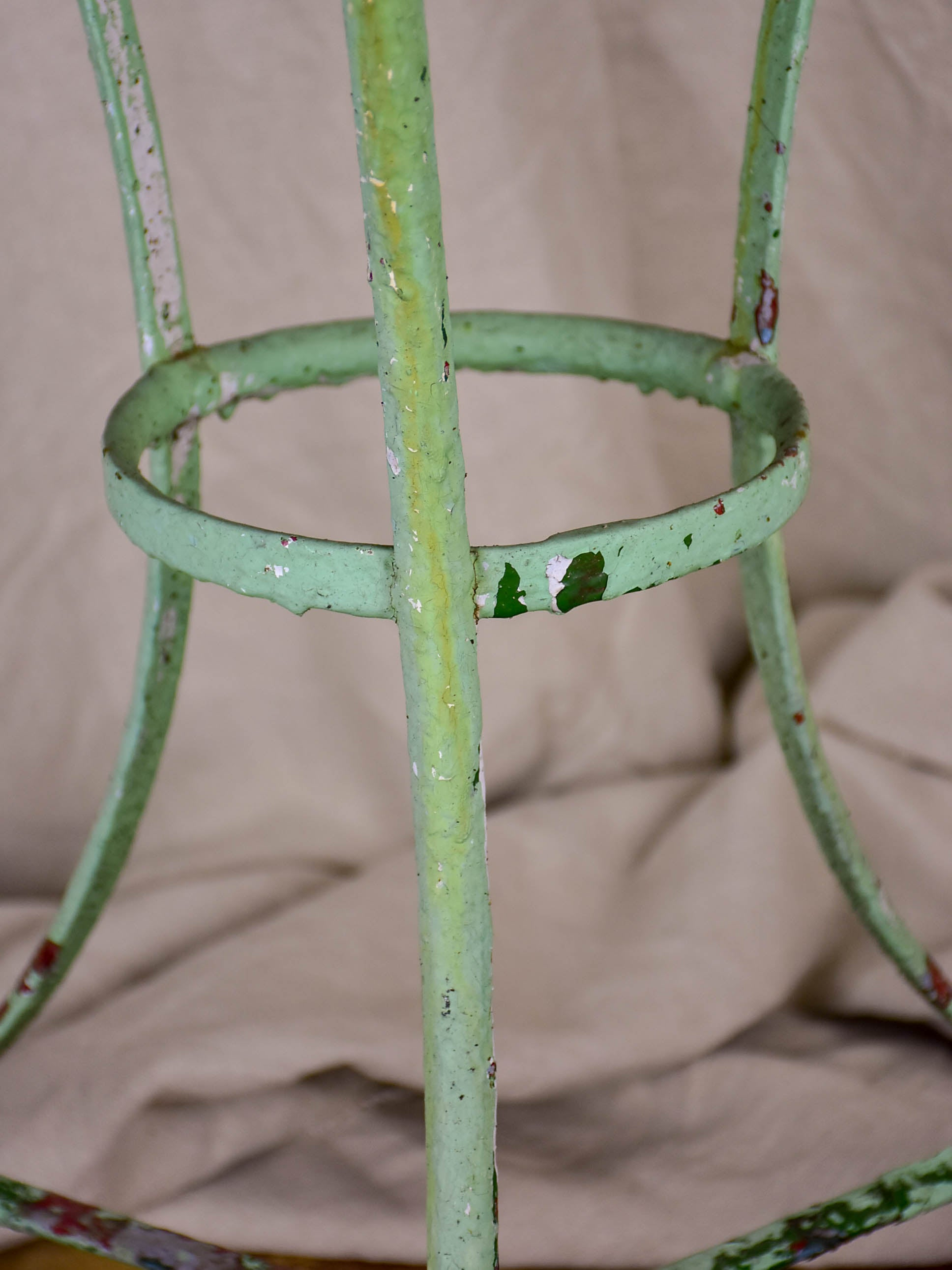 Antique French garden table with green patina