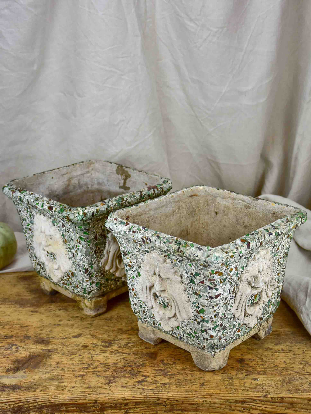 Pair of mid-century garden planters with masquerade