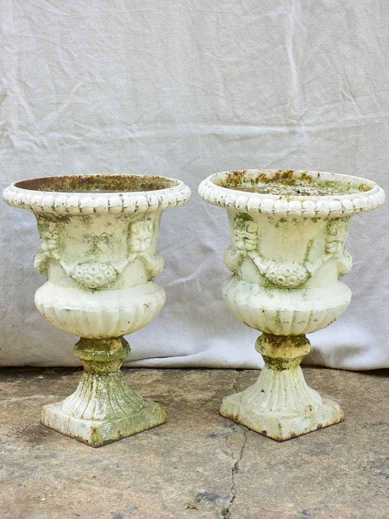 Pair of 19th Century cast iron Medici urns with white paint finish 17¼""