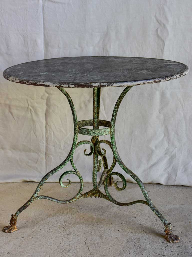 Late 19th Century round Arras garden table with claw feet 32""