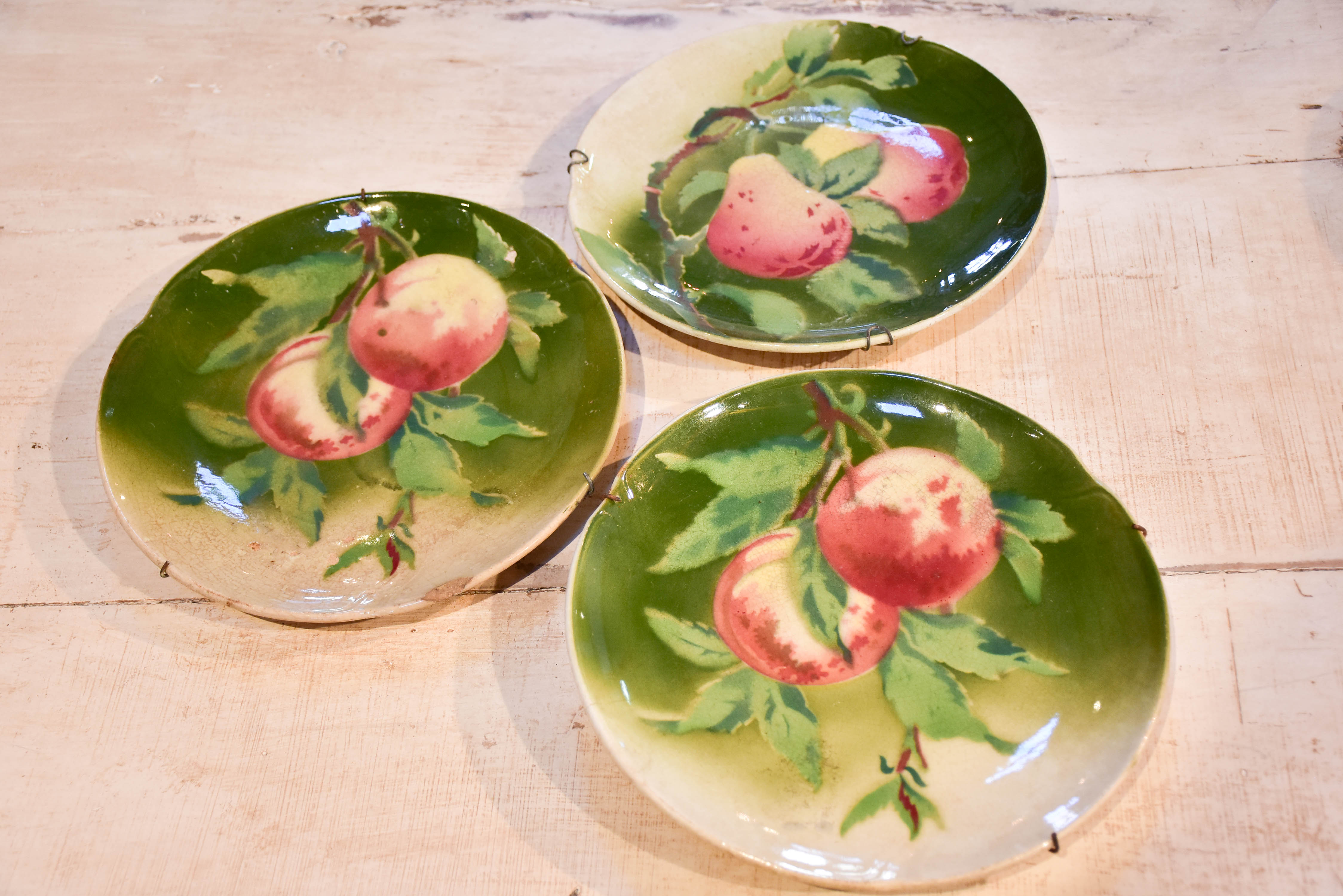 Three antique Gien plates with fruit