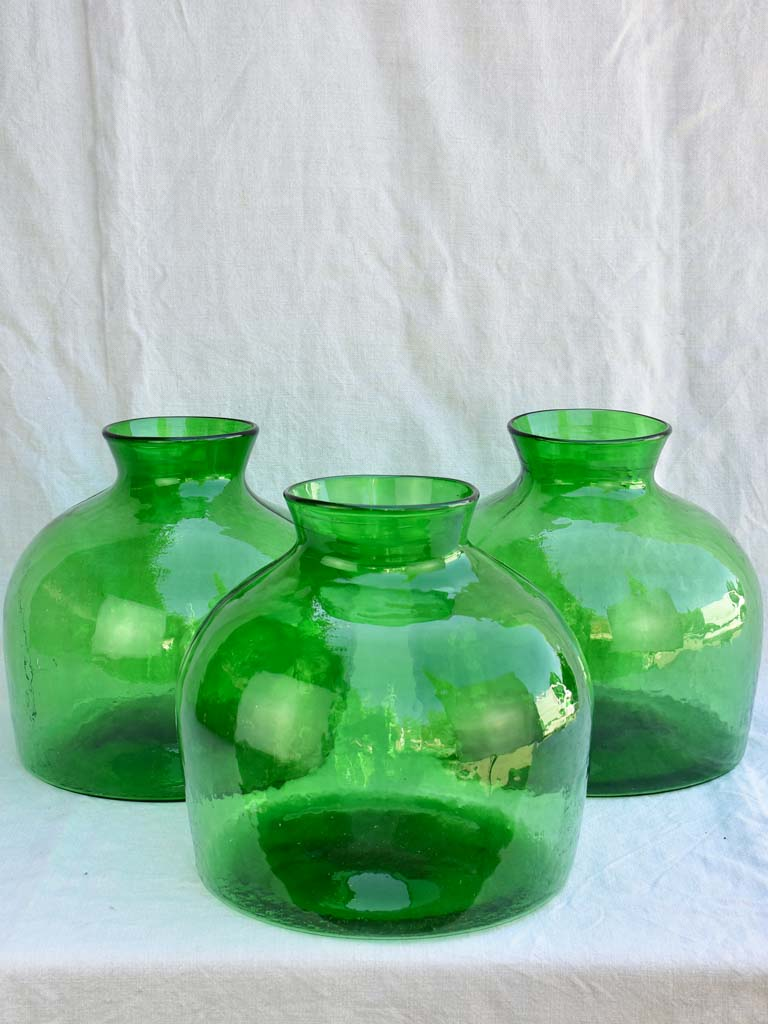 Three very large green glass vases / bottles 13½""