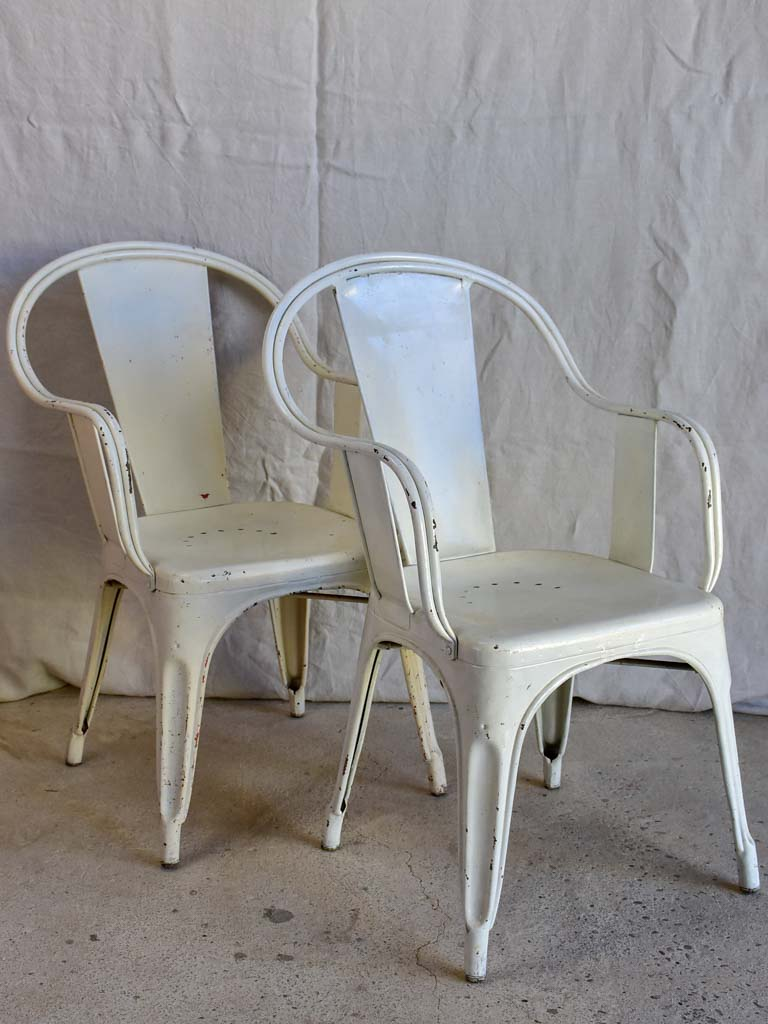 Pair of white Tolix armchairs - 1950's