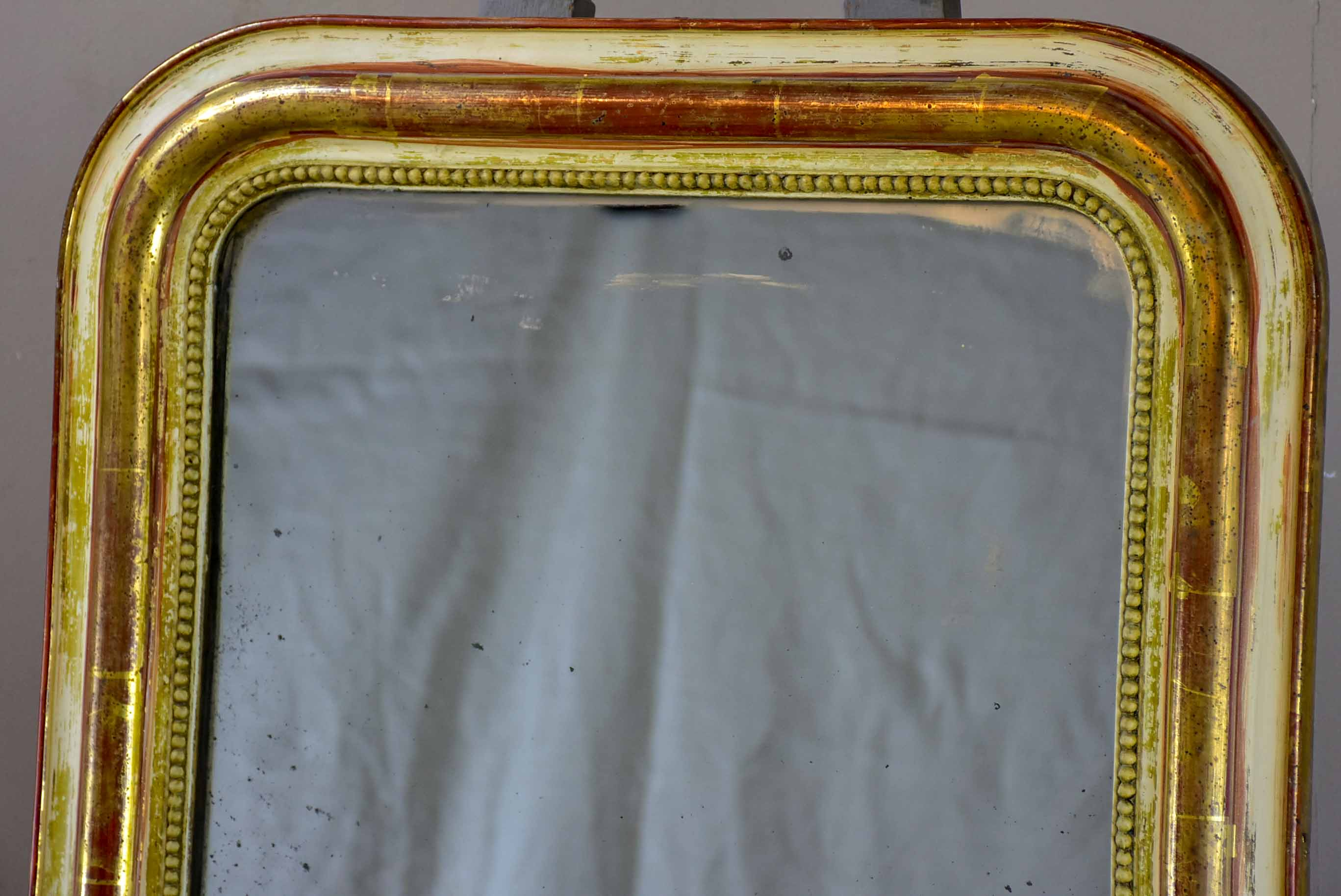 Rustic antique French Louis Philippe mirror with timeworn gilded frame