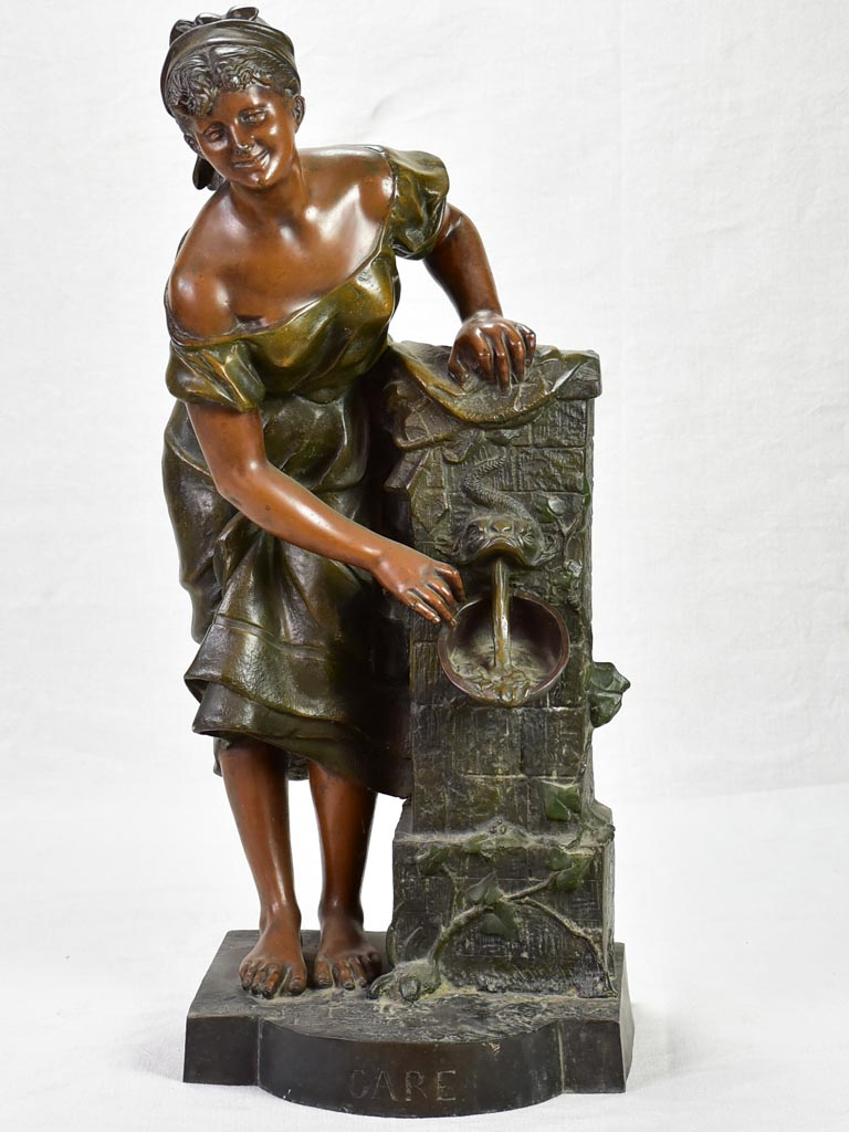Early twentieth century metal sculpture of a lady at a fountain 30¼""