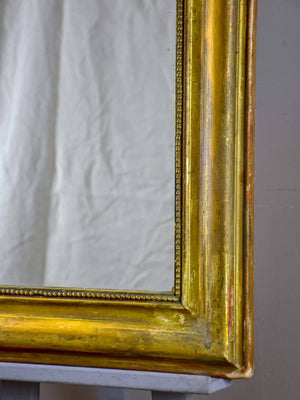 Antique French Louis Philippe mirror with gilded frame