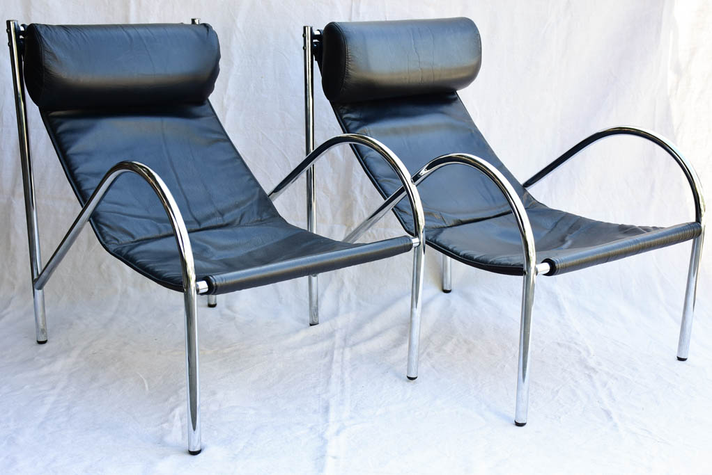 Pair of 1950's black leather and chrome armchairs in the style of Le Corbusier Charlotte Perriand