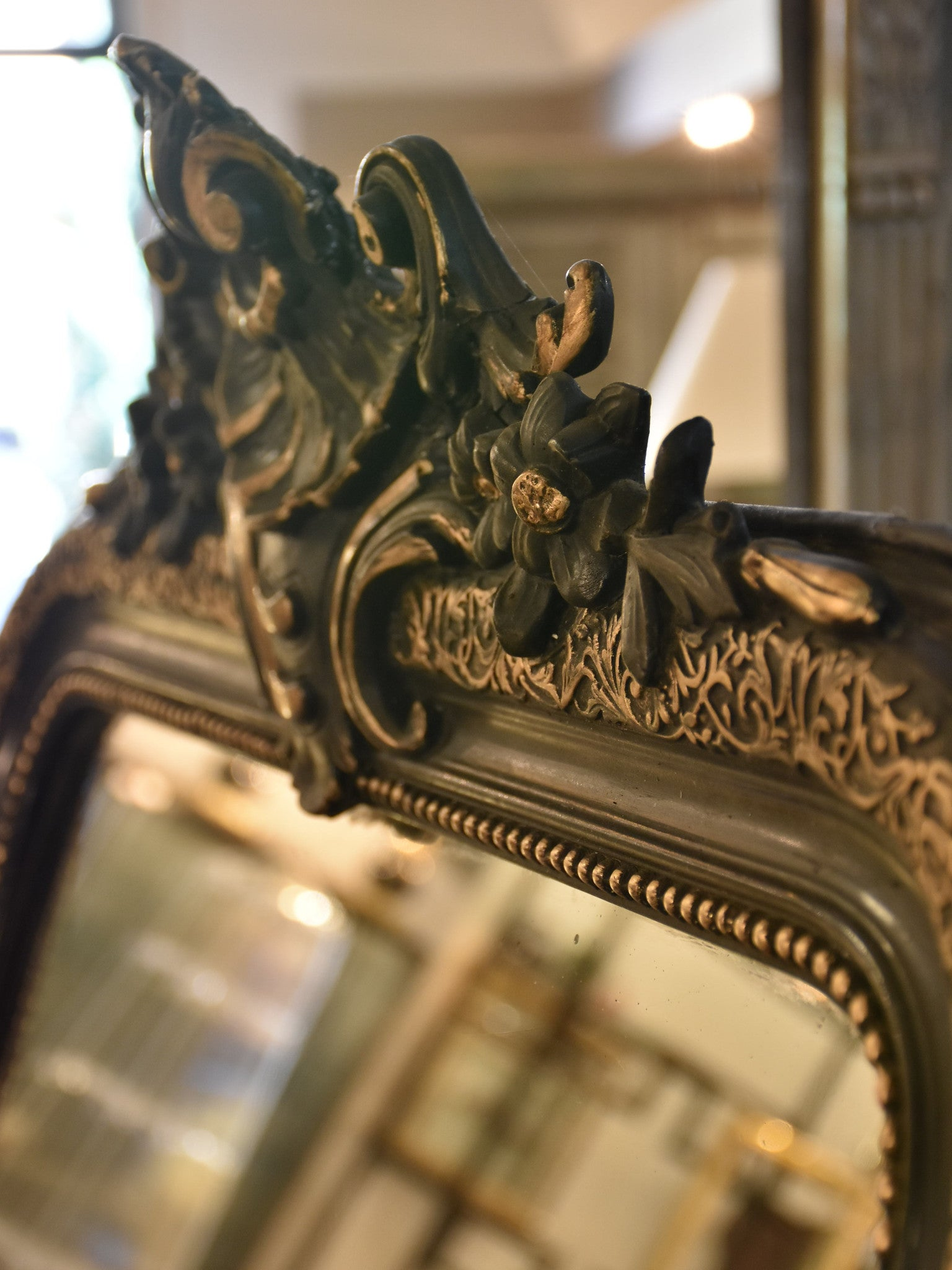 Late 19th century Napoleon III mirror with black and gold frame