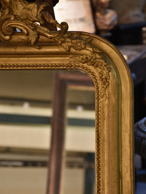 19th century Louis Philippe mirror with gilded frame and crest