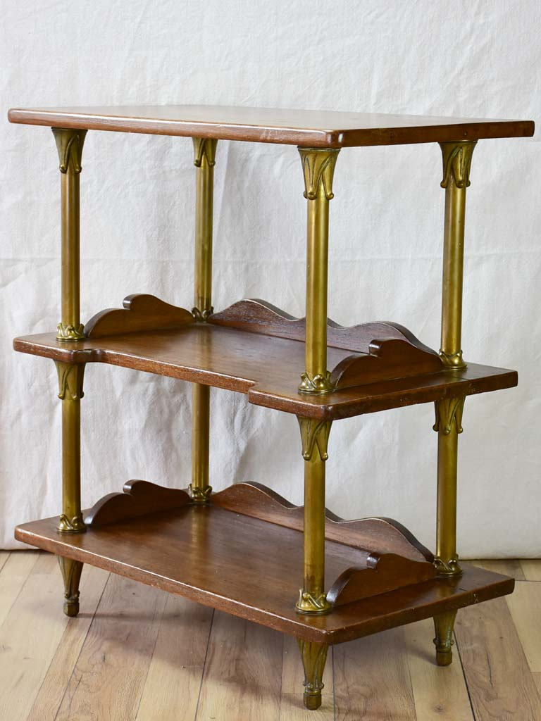 Early twentieth century shelving unit with bronze frame from a boutique 32¼""