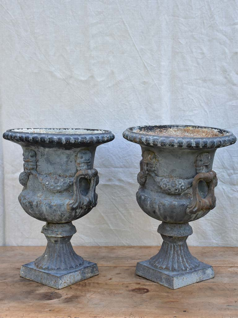Pair of Napoleon III cast iron garden urns
