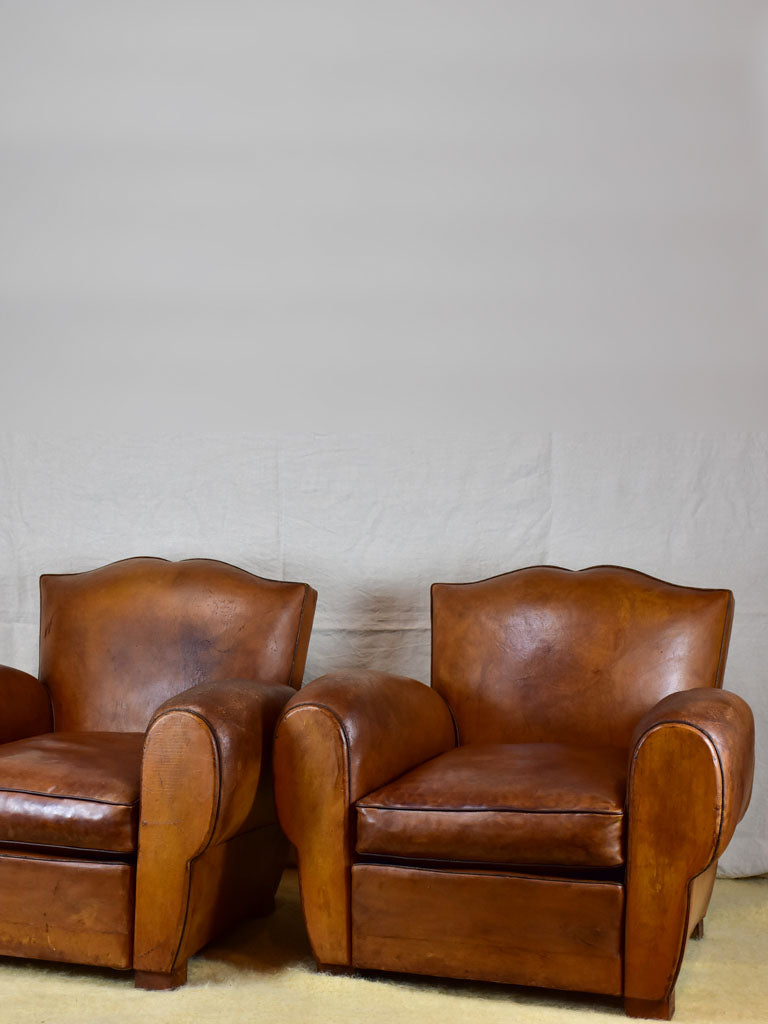 Pair of large mustache back vintage French club chairs