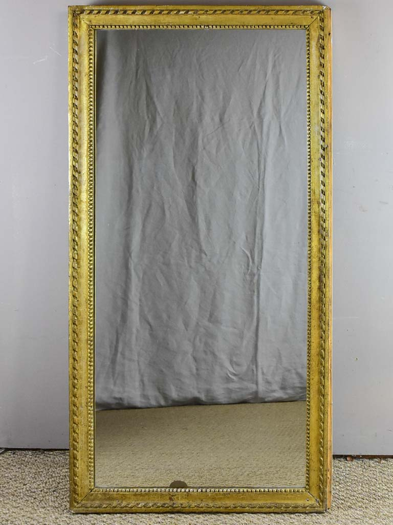 Early 19th Century French mirror with fatigued gold frame