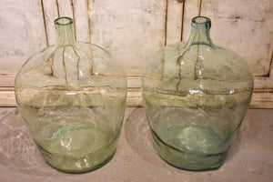 Pair of antique demijohn bottles