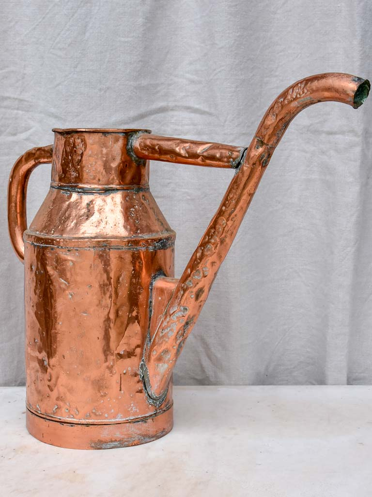 Rustic antique French polished copper watering can